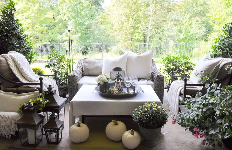 beautiful-outdoor-living-area-decorated-for-fall-with-white-pumkins_