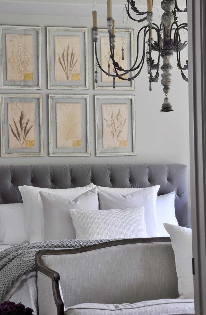beautiful-gray-and-white-bedroom-with-large-chandelier-and-tufted-headboard