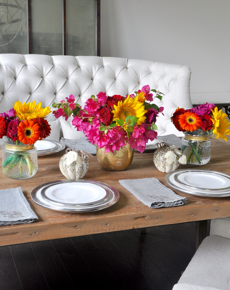 bright-floral-centerpiece-in-a-neutral-dining-room