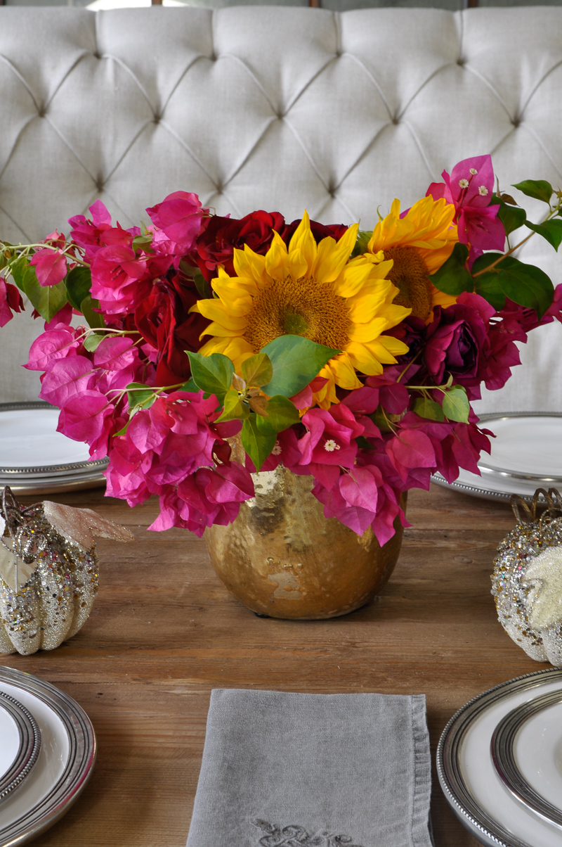 bright-pink-and-yellow-centerpiece-floral-arrangement-gold-vase-and-glitter-pumpkins