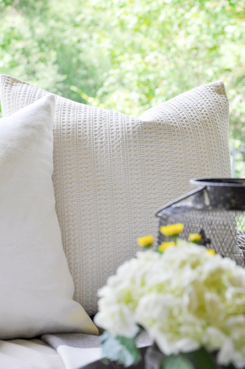pottery-barn-pillows-on-covered-pation-for-fall-so-pretty