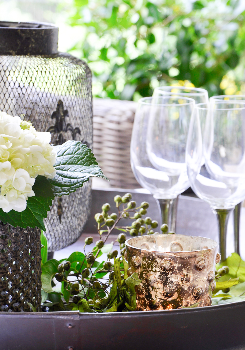 wine-glasses-flowers-and-votive-on-a-decorative-tray_