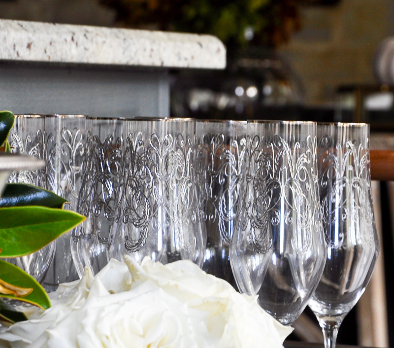 beautiful-champagne-glasses-on-bar-cart_