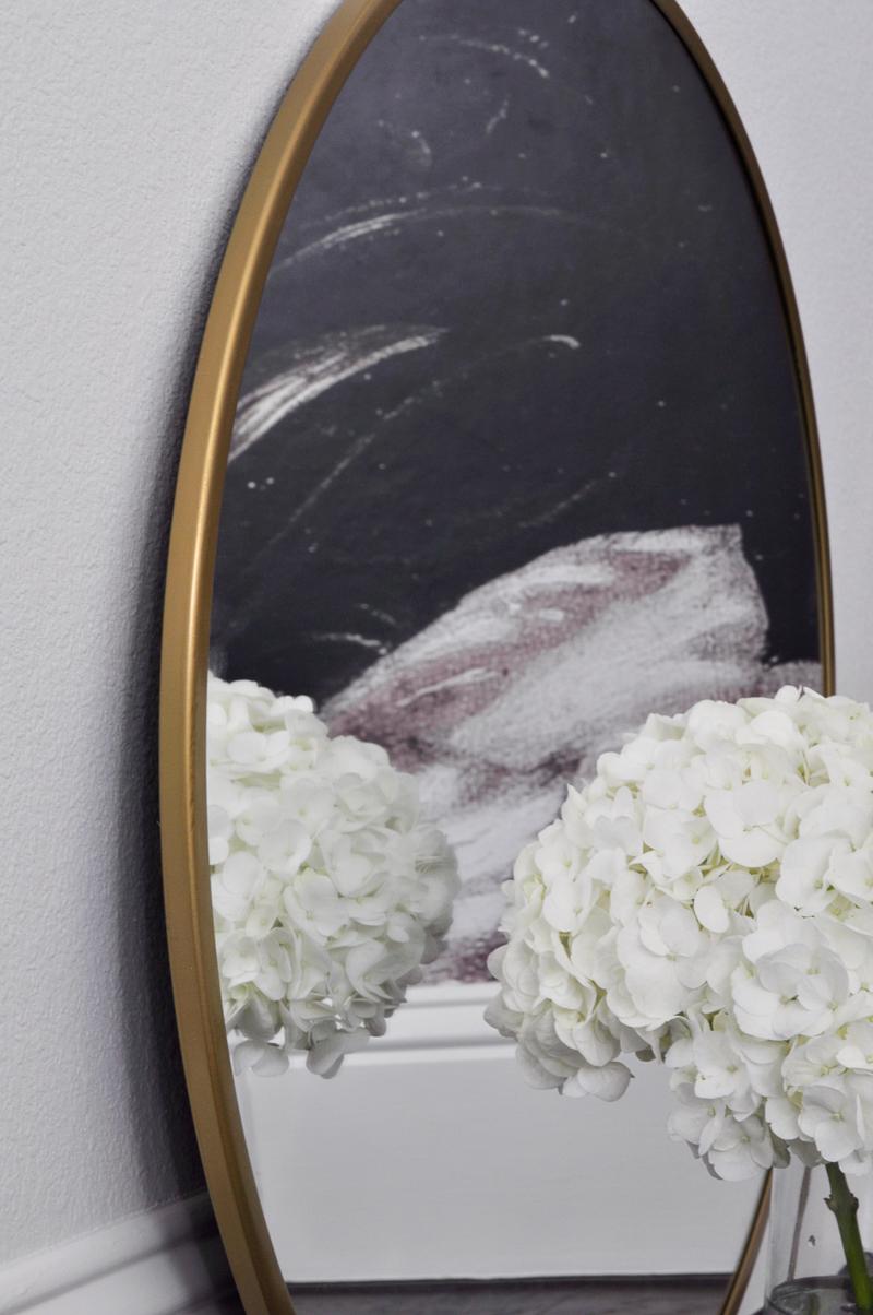 brass-rimmed-round-mirror