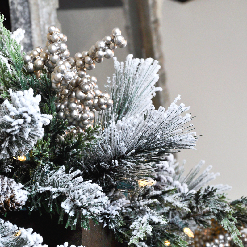 A Rustic Holiday Mantle with Flocked Garland