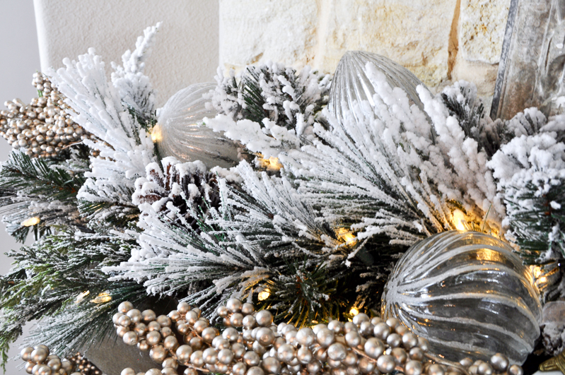 christmas-ornaments-added-to-garland-on-mantle_