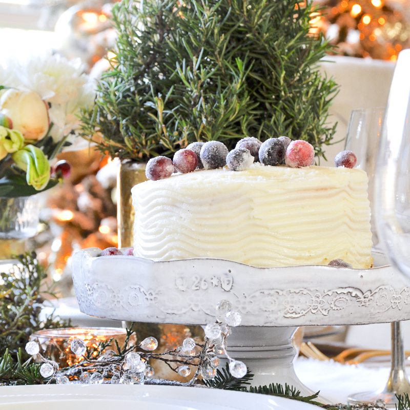 classic-christmas-table-with-white-cake-and-sugared-cranberries