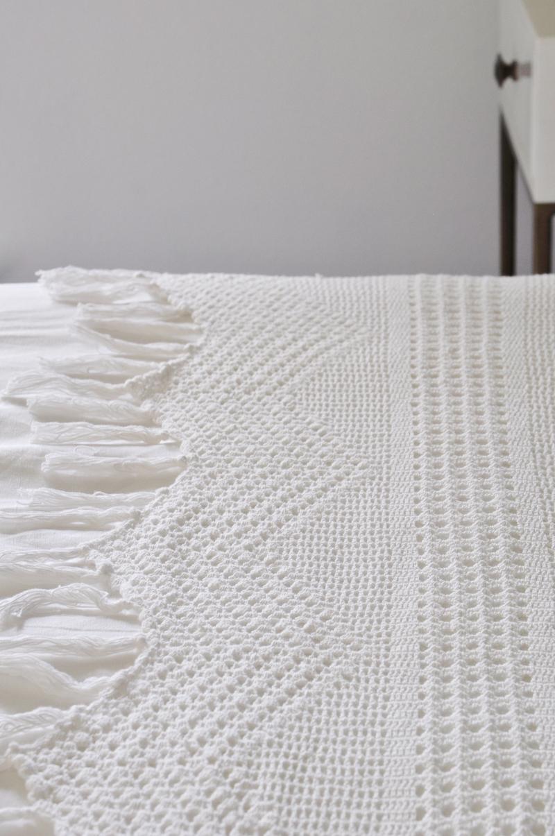 crochet-detail-on-linen-sheet-by-pom-pom-at-home_