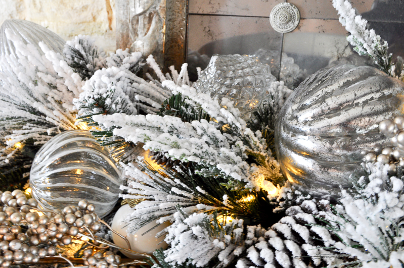 mercury-glass-ornaments-added-to-garland-on-mantle_