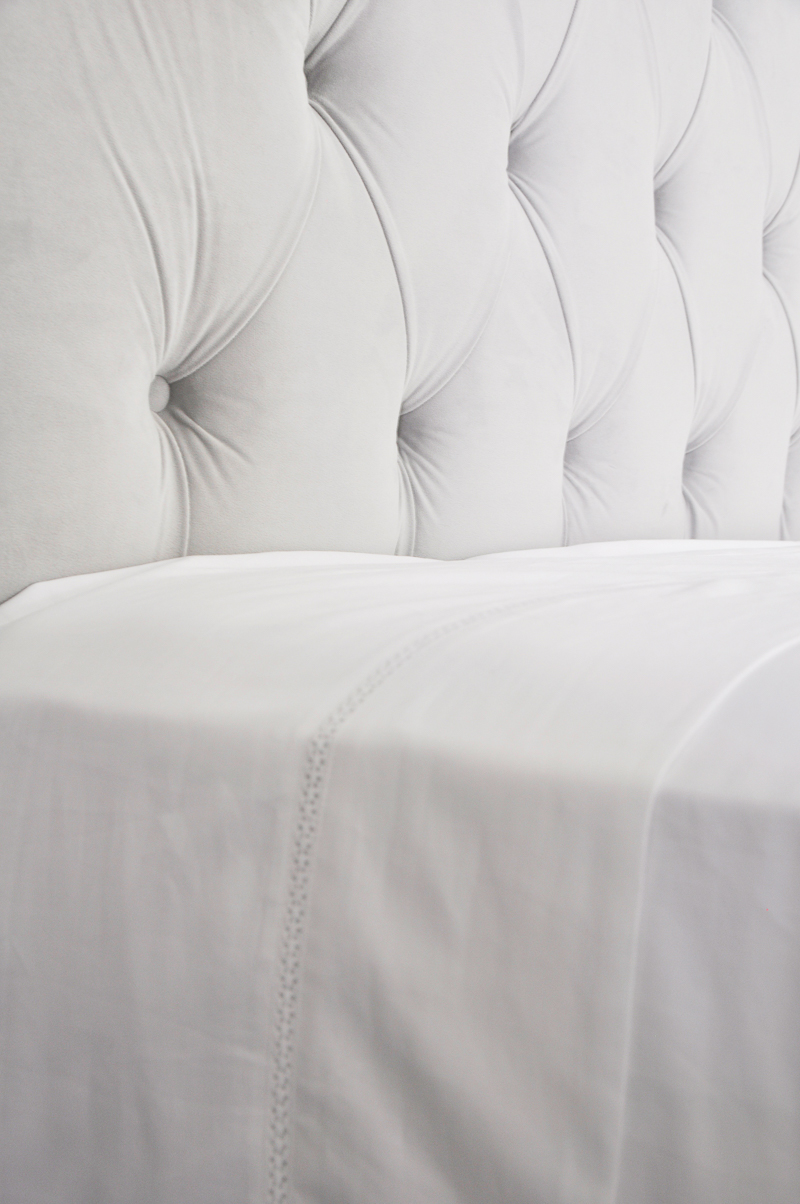 white-sheets-and-gray-headboard-beautiful-bedroom-look