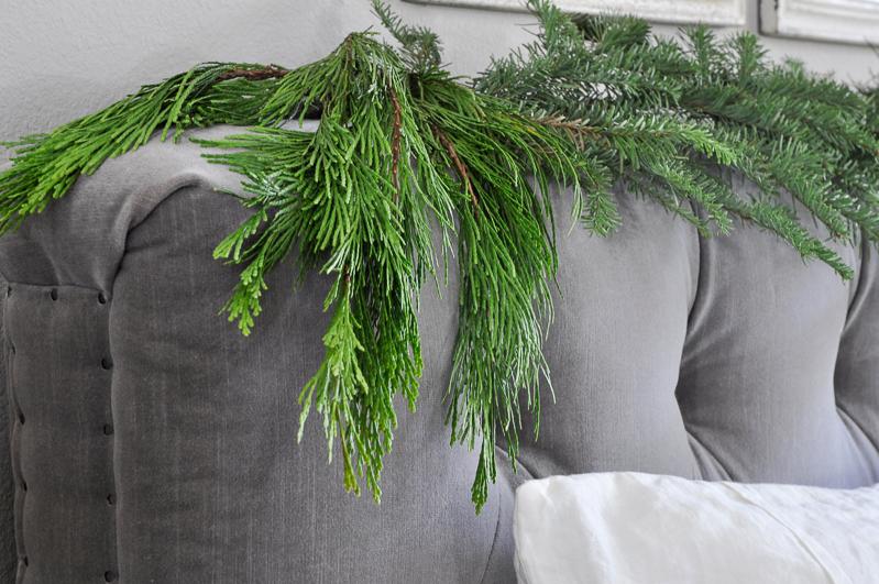 christmas-garland-on-tufted-headboard_