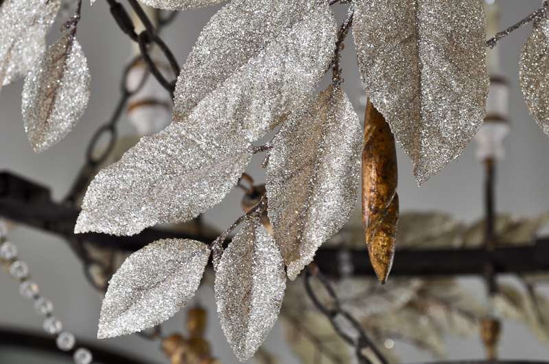 gold-leaves-on-chandelier-decorated-for-christmas_