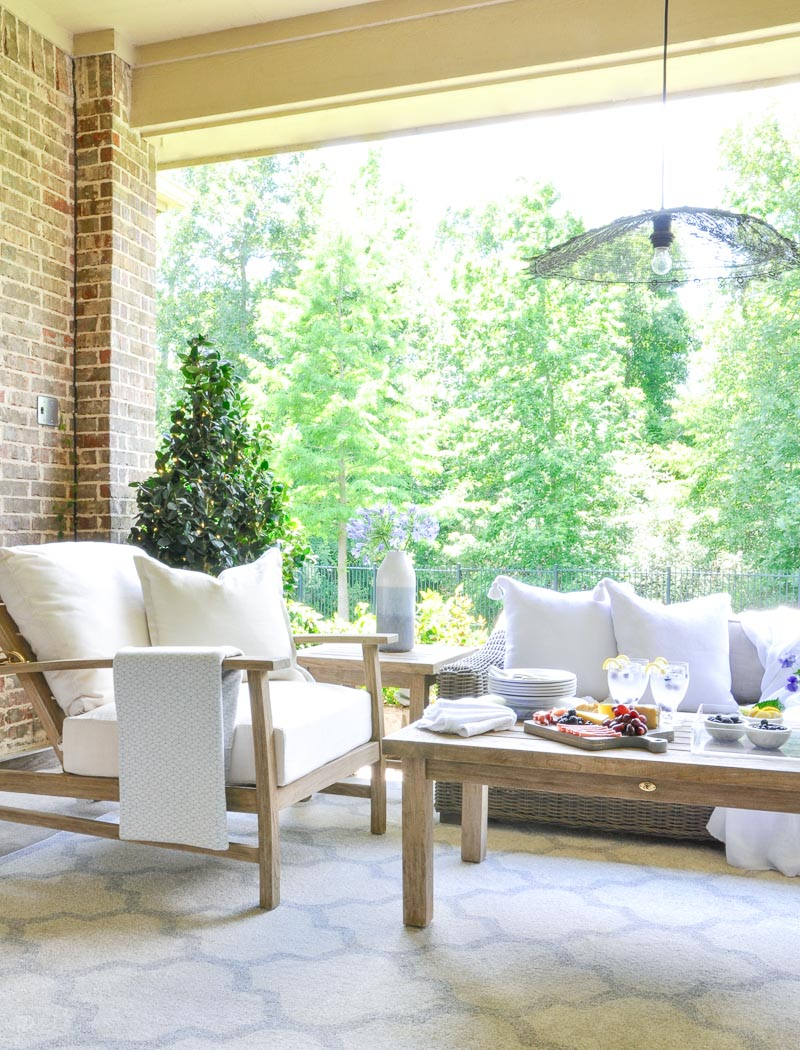 Beautiful outdoor space teak furnishings white cushions