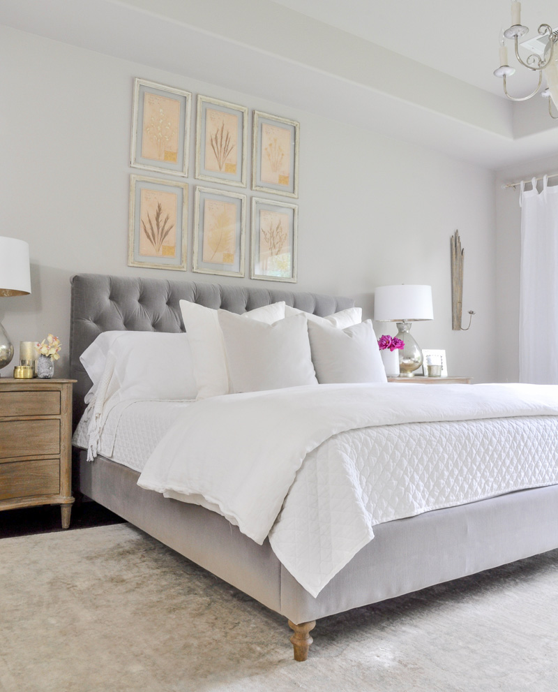 gray tufted bed