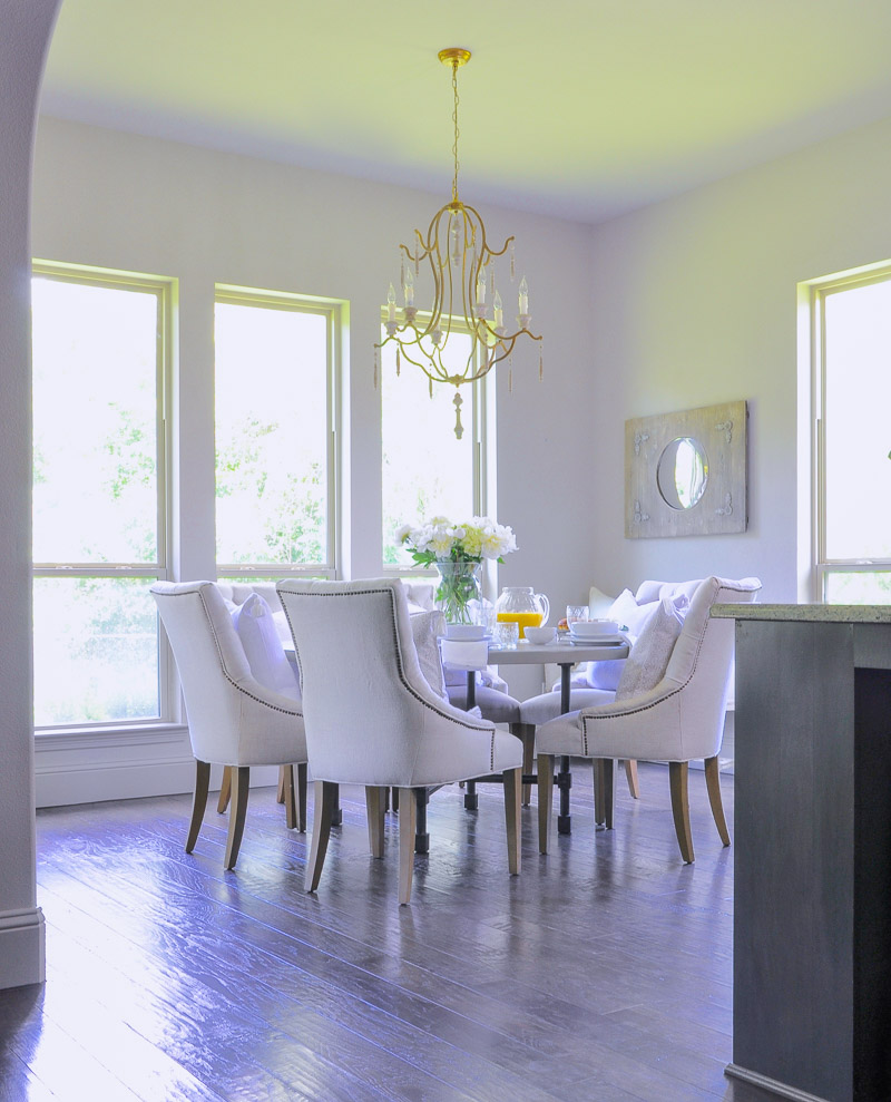 bright white breakfast nook with round table