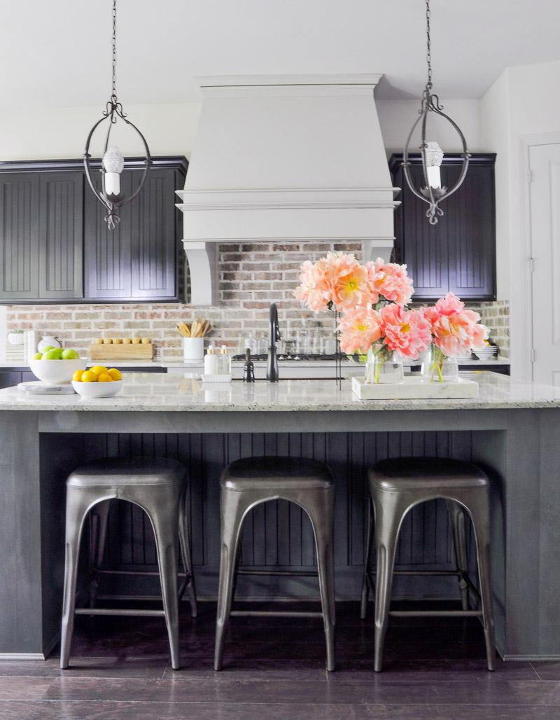 beautiful kitchen large vent hood