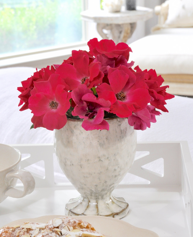 vase of flowers on breakfast tray