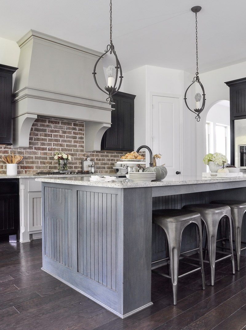 beautiful kitchen with brick backsplash