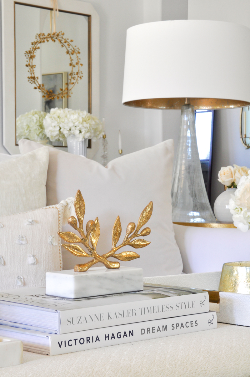 gold accessories in elegant white living room
