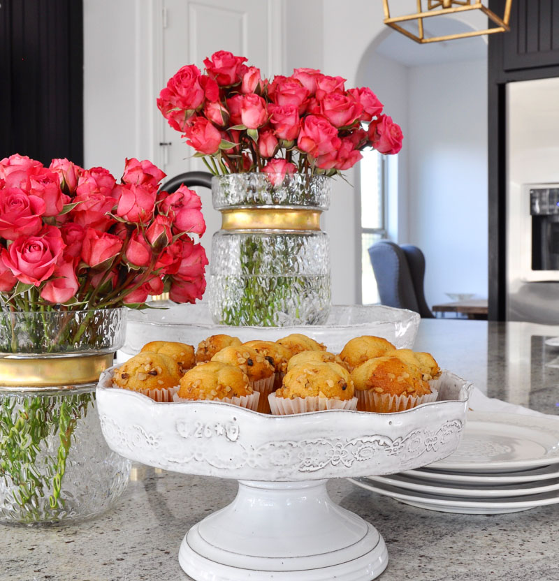 beautiful kitchen counter with muffins and flowers