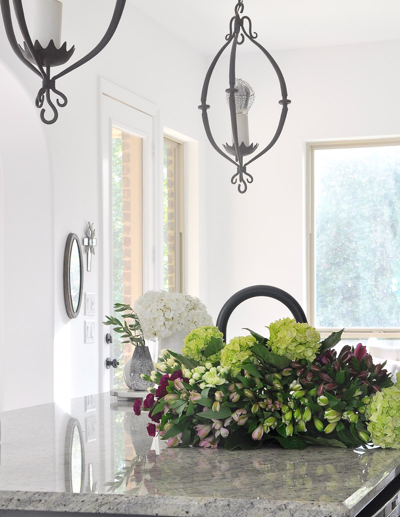 kitchen with flowers in an inviting home