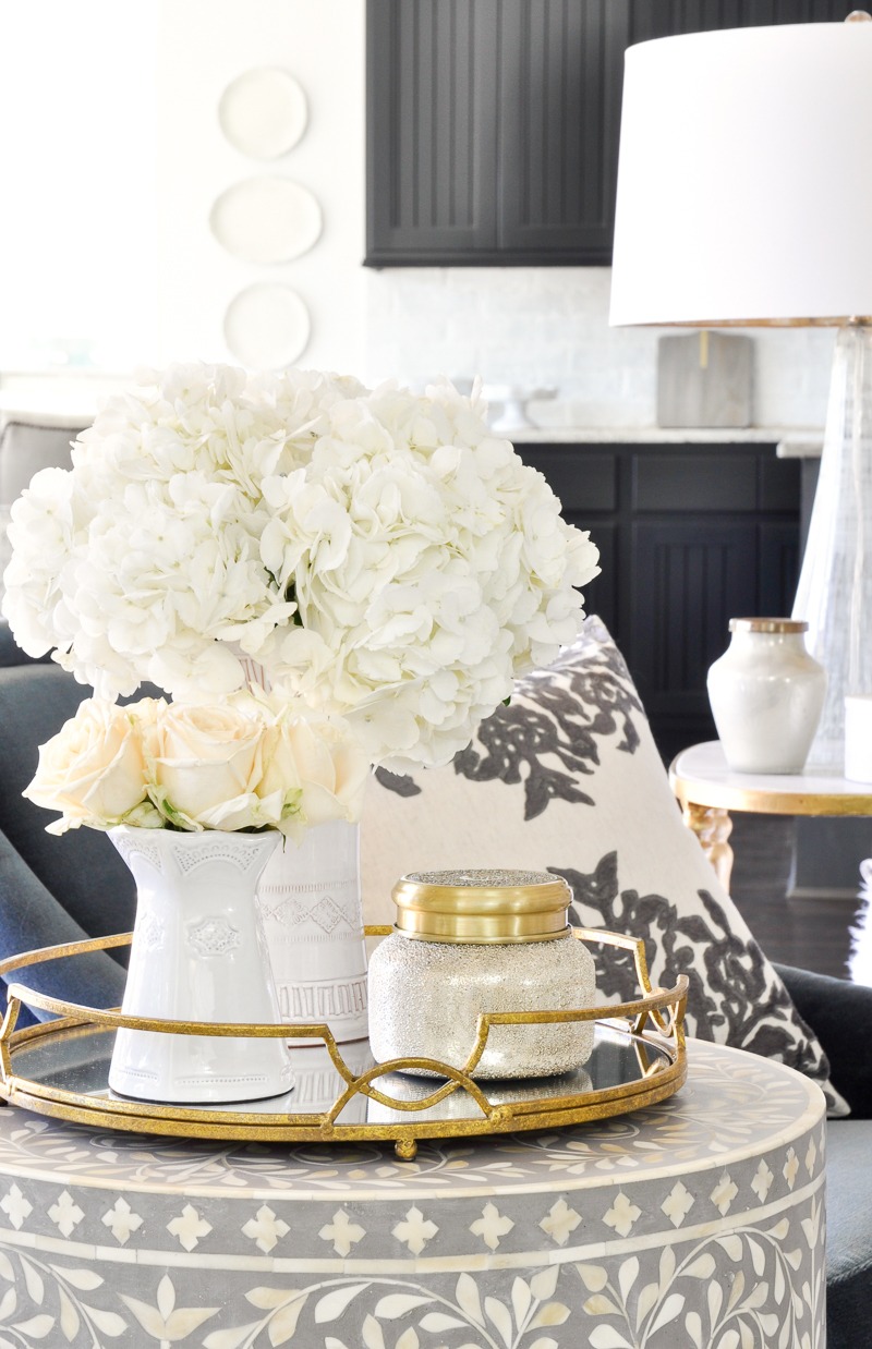 round end table gold tray white vases