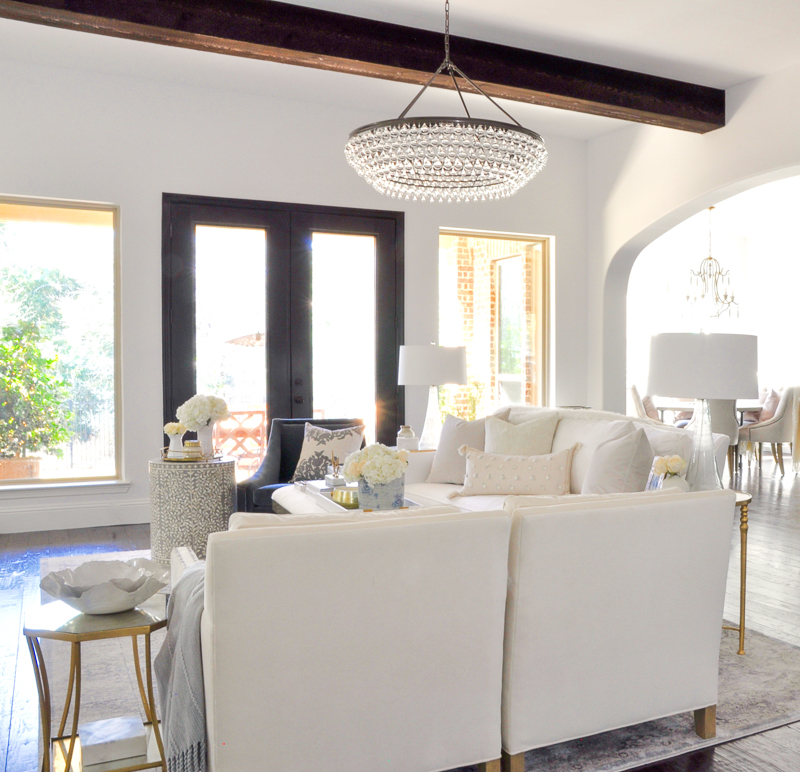 timeless and elegant white living room with beams
