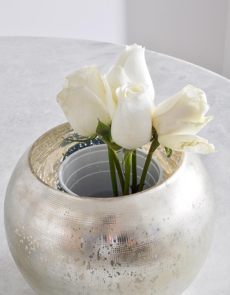 arranging rose in a round vase