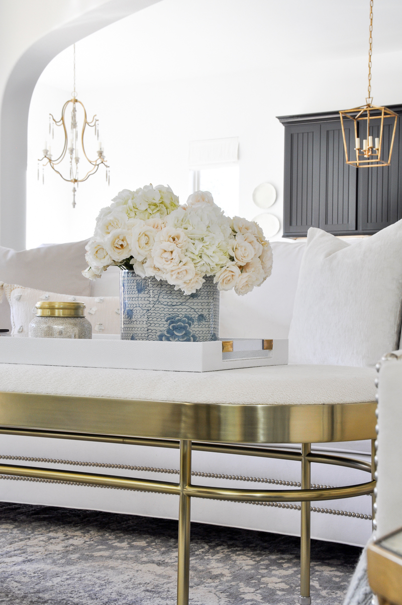 elegant white living room with gold