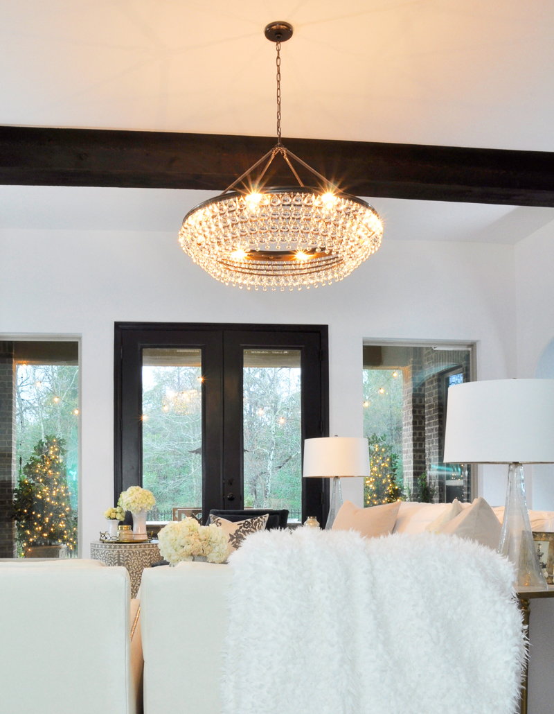 beautiful living room with statement chandelier