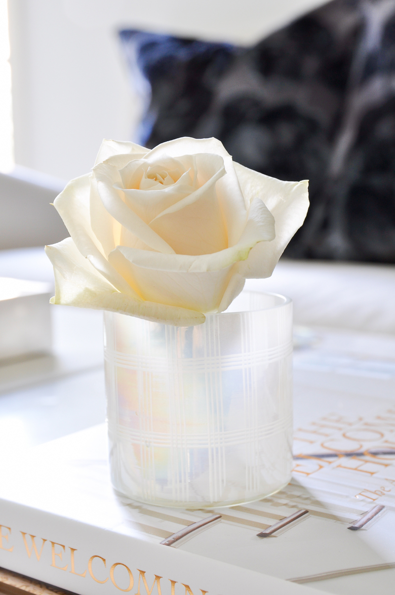 single white rose arranged in votive