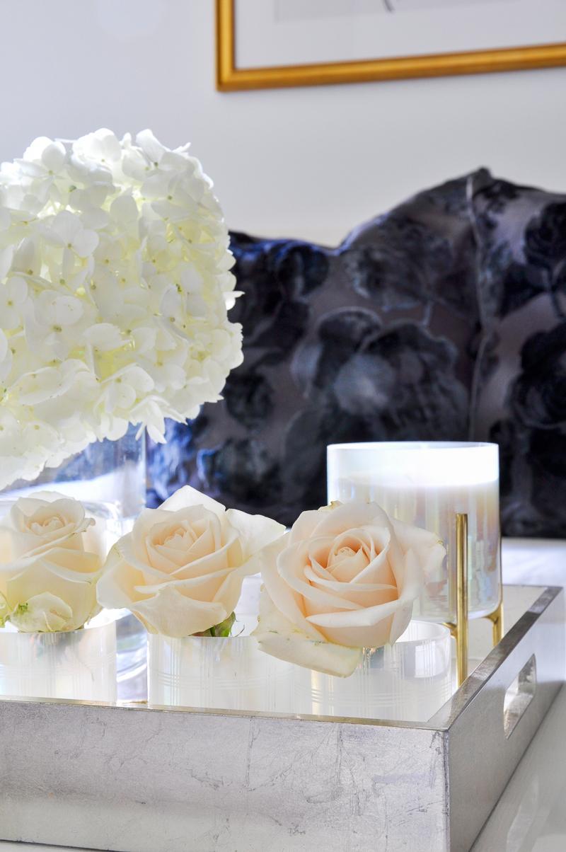 roses arranged in votives