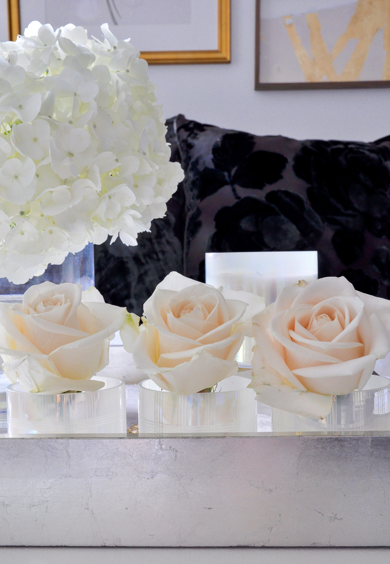 roses arranged in votives