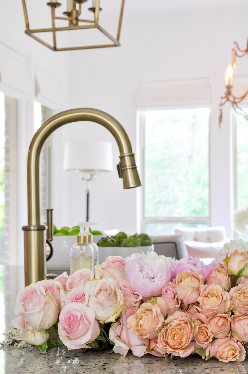 Beautiful spring flowers in kitchen sink