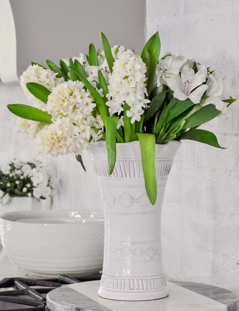 Beautiful spring flowers in white vase