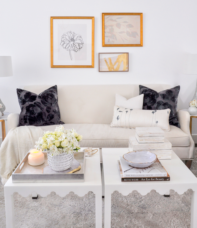 beautiful white living room with gold accents