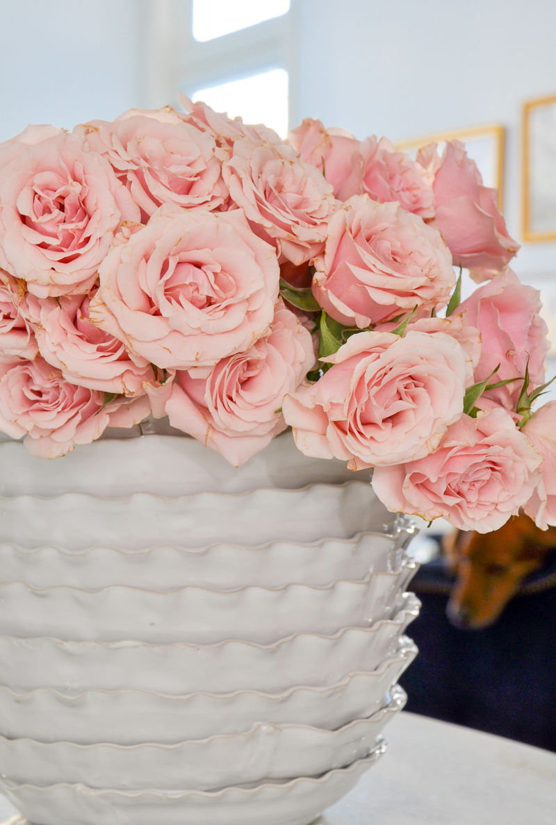 beautiful white vase with pink spray roses