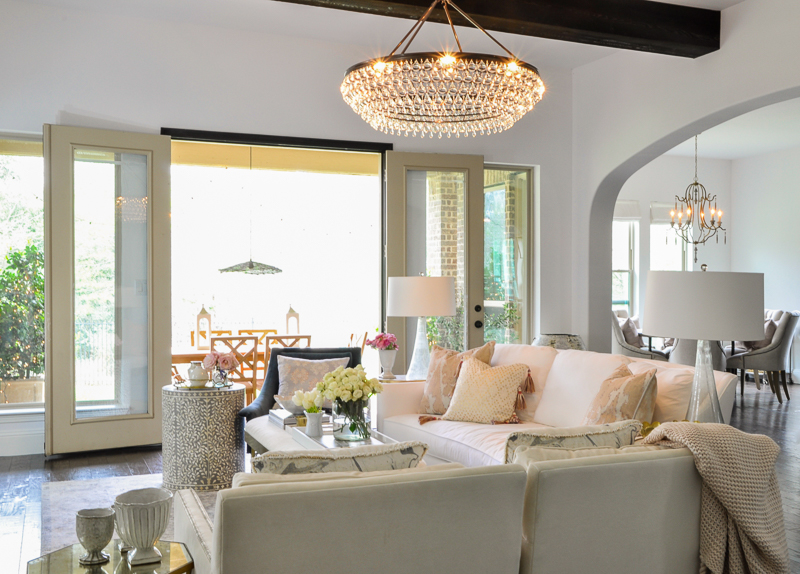 beautiful bright spring living room with elegant chandelier