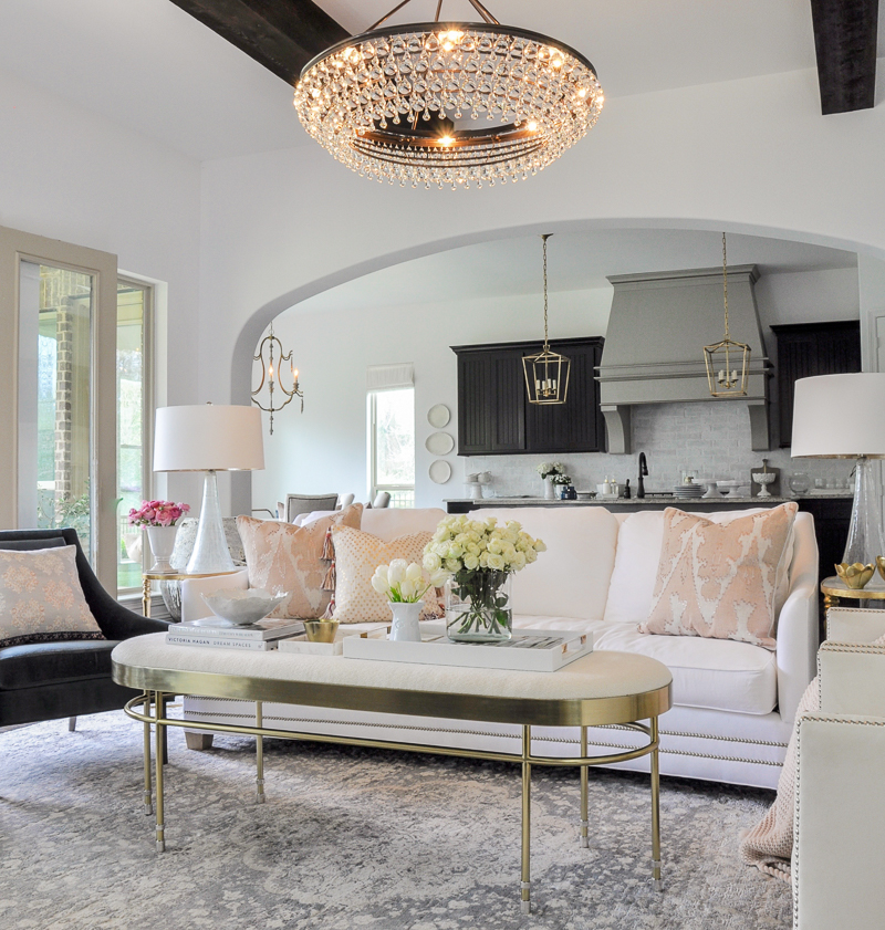 blush accents in a white living room decorated for spring
