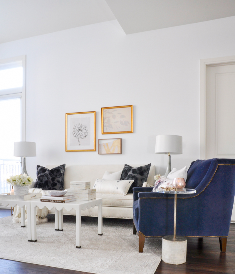bright white living room with gold and navy accents