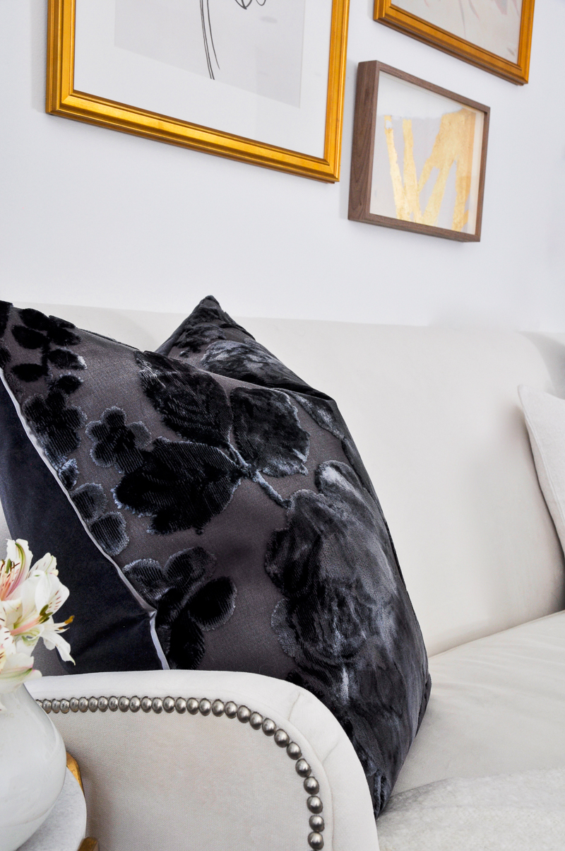 burnout velvet pillow navy on white sofa