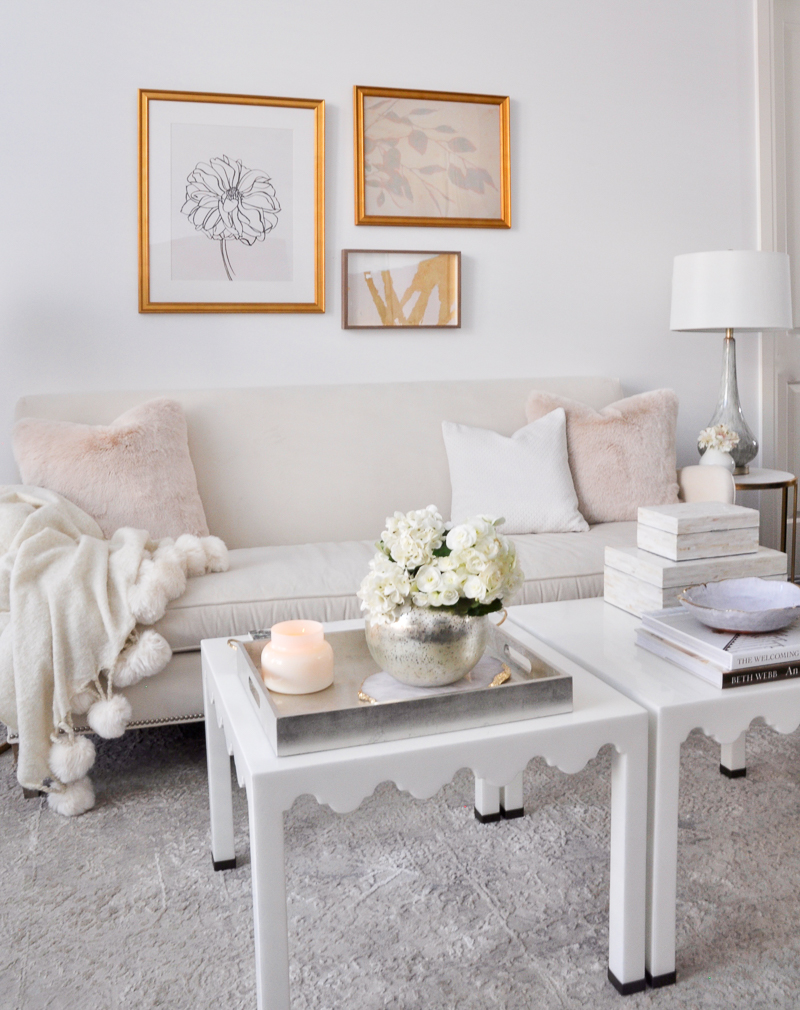 elegant white living room with spring decor in blush and gold accents