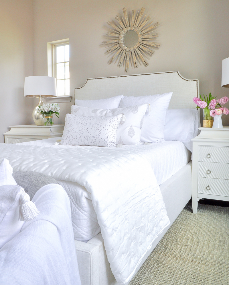 guest bedroom with white bed and bedding