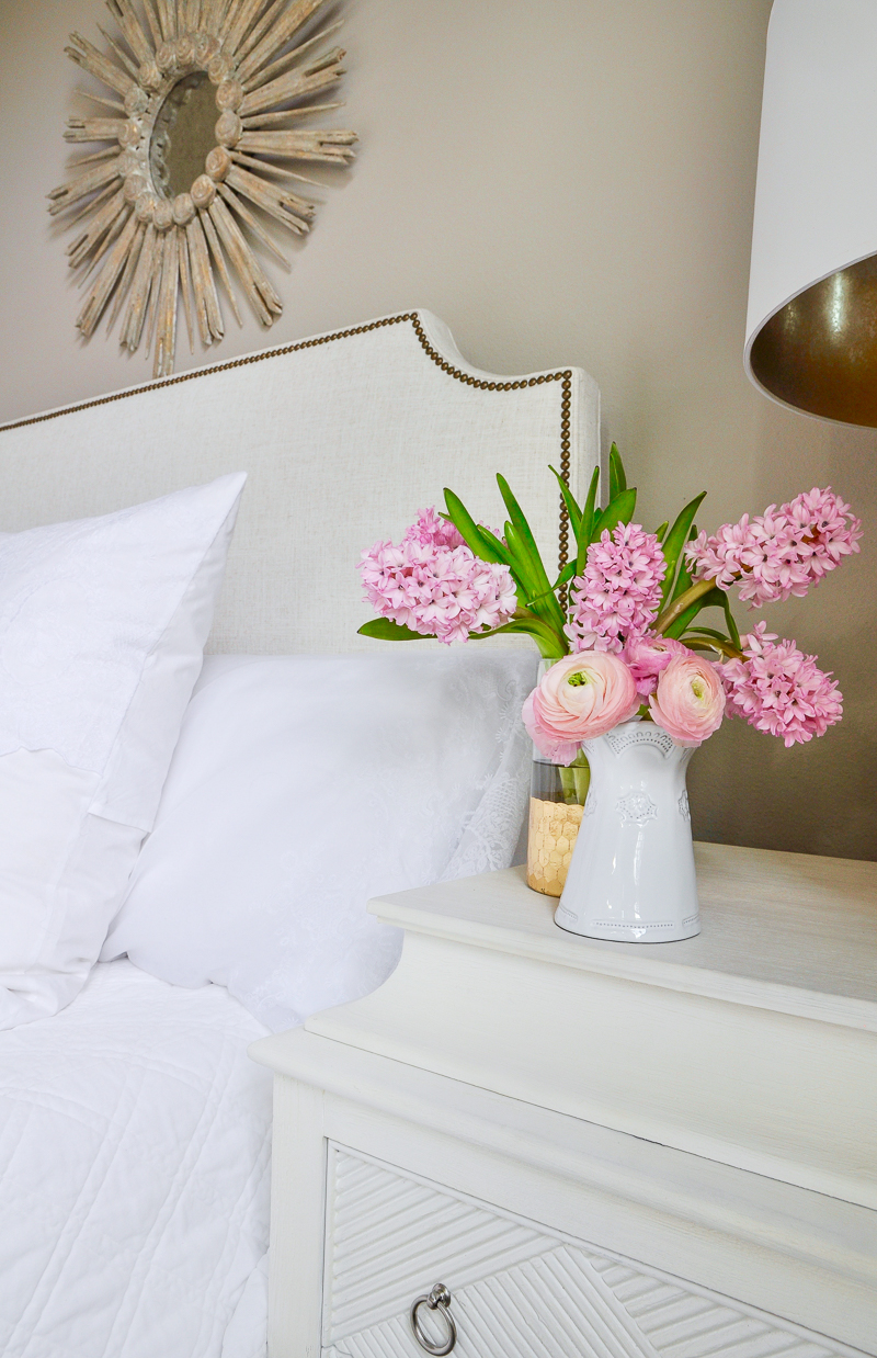 guest bedroom with white bedding