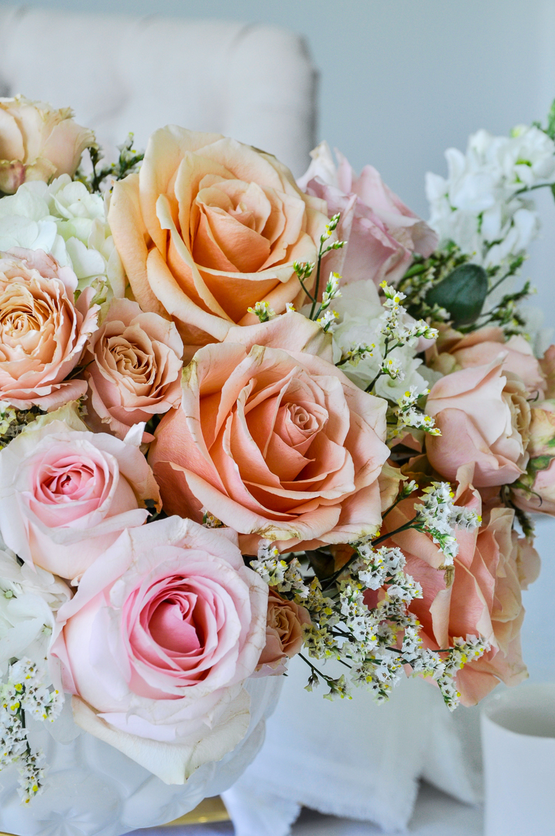 peach and blush rose floral arrangement