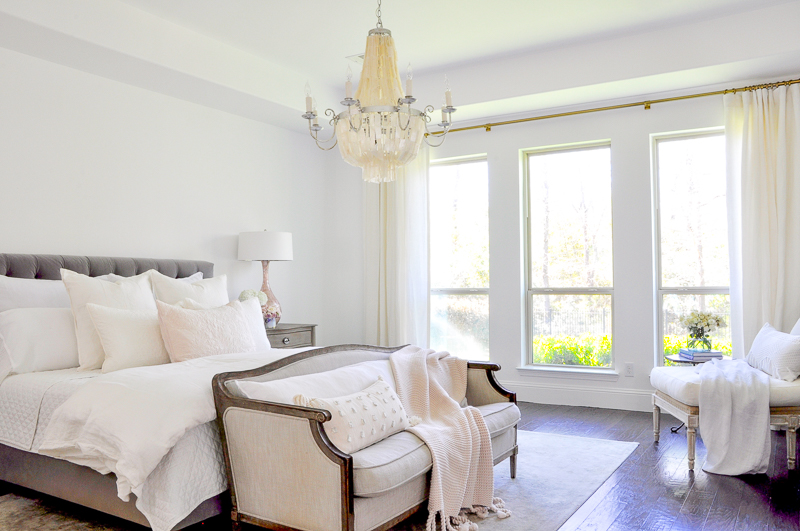 white bedroom with blush accents