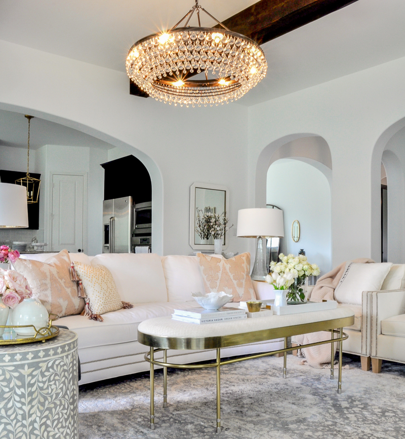white living room with blush and gold accents
