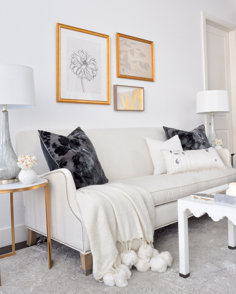white living room with gold accents