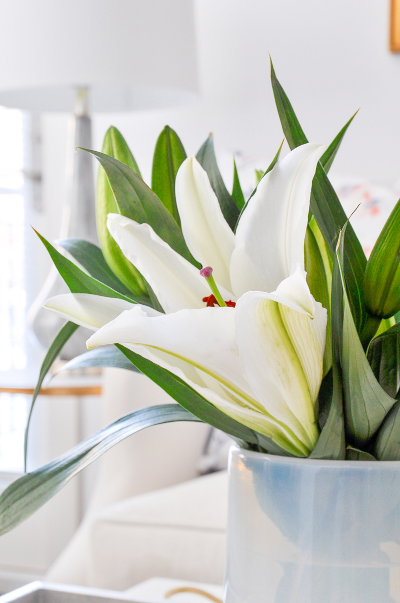 white vase with lilies