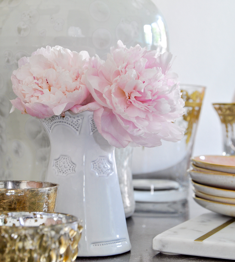 white vase with pink peonies